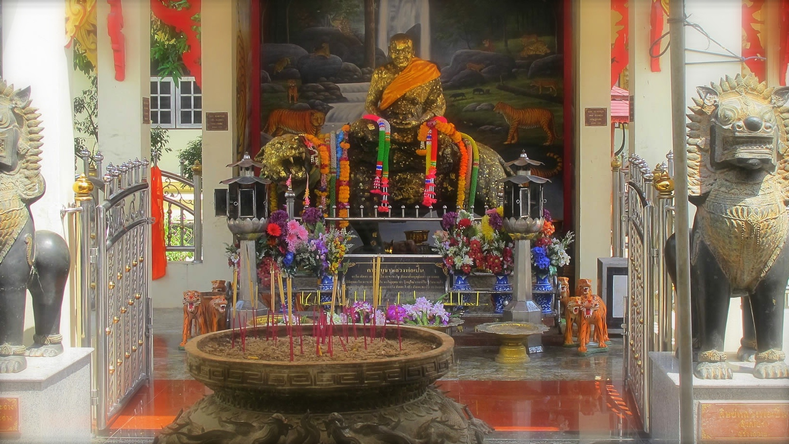 Luang Por Phern statue riding tiger Wat Bang Pra