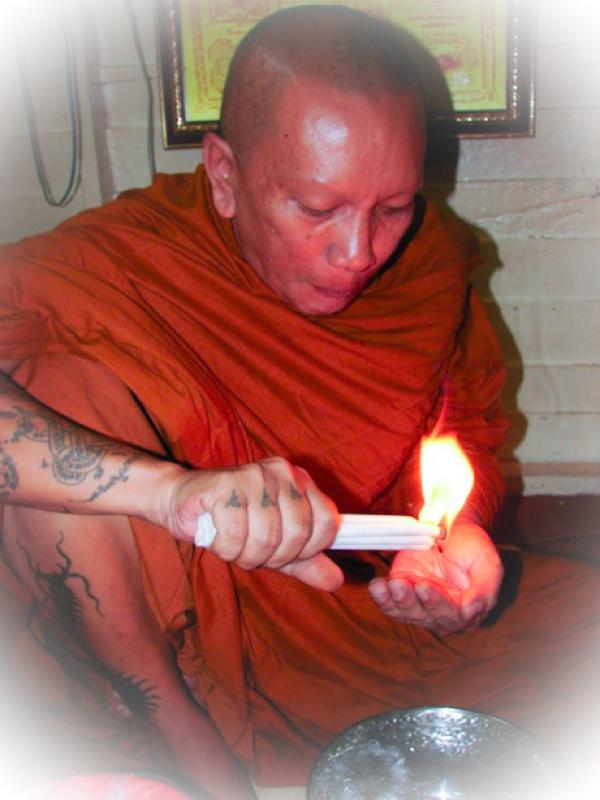 Luang Por Chanai performs Kasina Magic using a candle.
